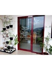 Mayura Apothecary - Front door with a small herbs garden