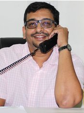 Dr. Nilesh Pagaria - Ace Dental Hospital - Dental Clinic in India